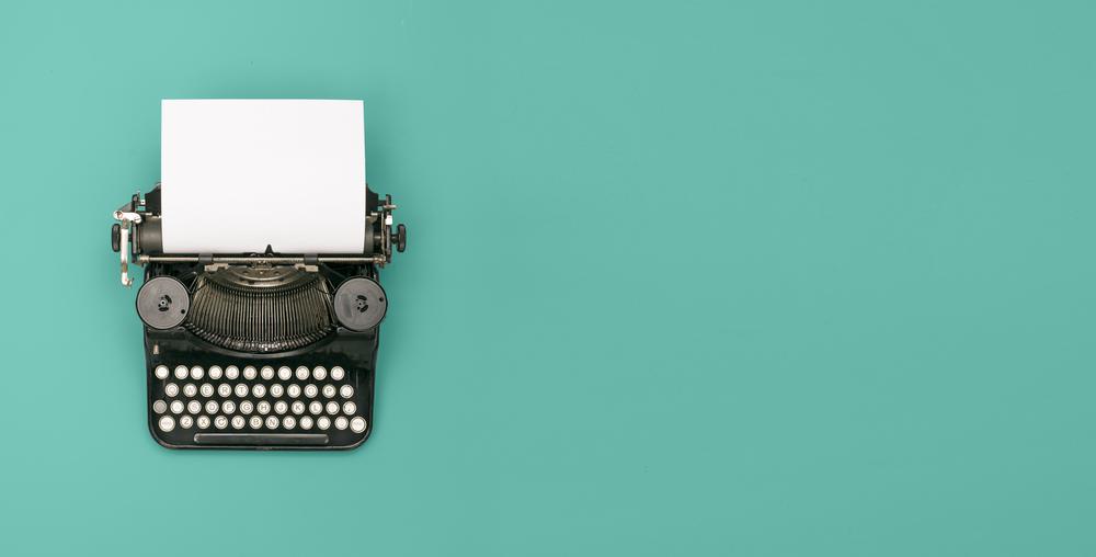 typewriter on blue background